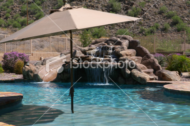 umbrella-in-front-of-rock-pool